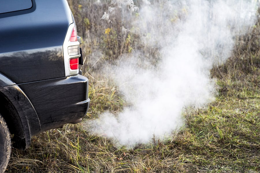 smoke fumes coming from a car exhaust