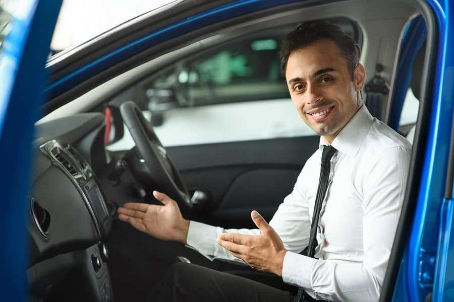 car salesman using sales tactics