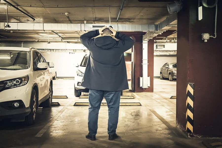 man finding his car stolen