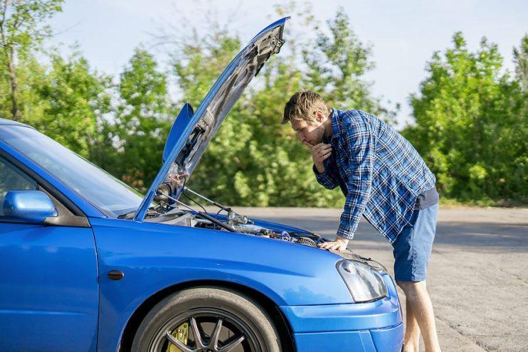 a man checking his juddering car