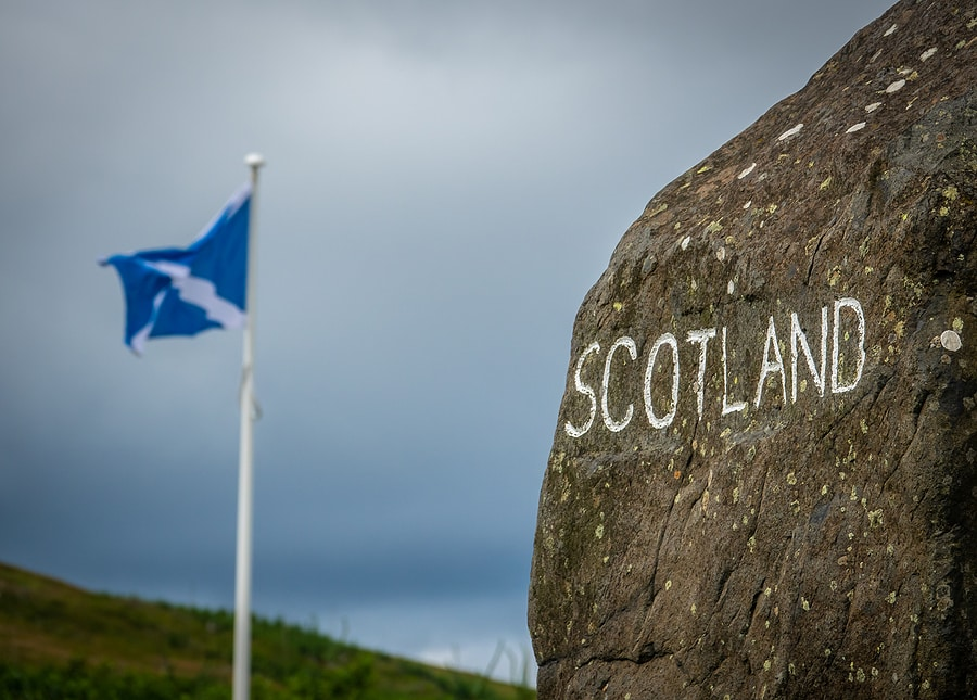 Scotland stone sign and flag