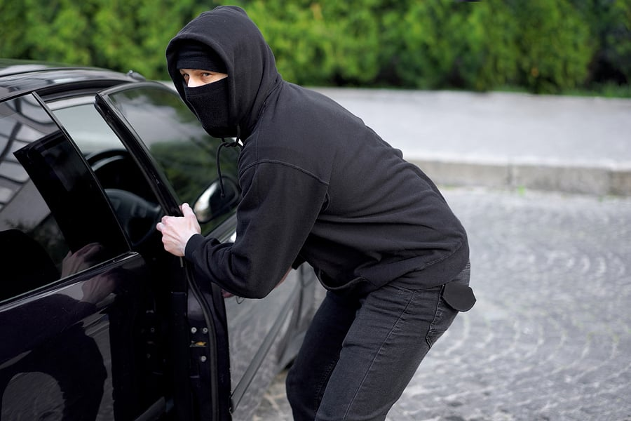 car being stolen by a thief